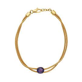 Yellow gold bracelet with purple sapphire