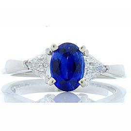 0.97 Carat Oval Blue Sapphire and Trillion White Diamond Platinum Cocktail Ring