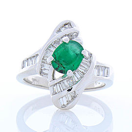 1.00 Carat Oval Emerald and Invisible Set Diamond Cocktail Ring in 14 Karat Gold