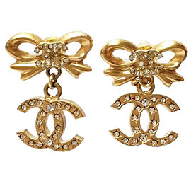 Chanel Gold Tone Metal & Crystal Ribbon Bow CC Dangle Piercing Earrings