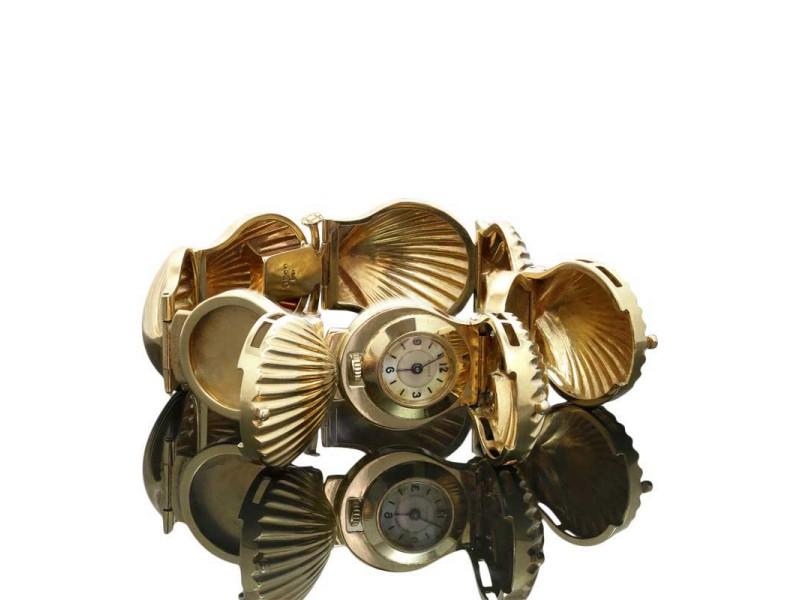 J. Shulz 14K Yellow Gold Diamond Ruby Seashell Bracelet Locket Watch Circa 1925