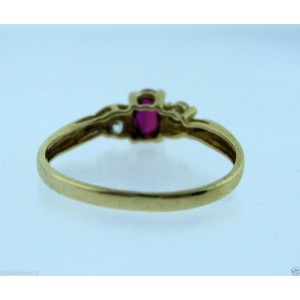 10K YELLOW GOLD RED STONE LADIES RING SIZE 6.75