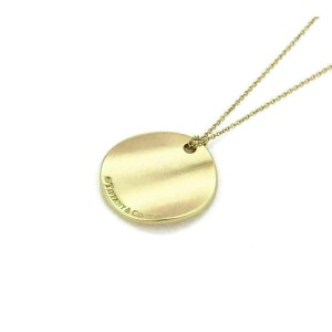 Tiffany & Co. Notes 18k Yellow Gold Round Wave Pendant