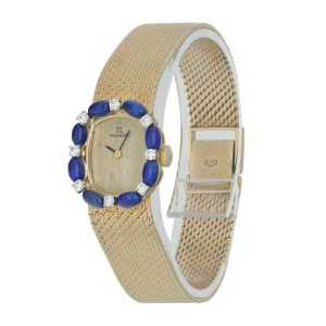 Movado 14K Yellow Gold Blue Enamel with Diamond bezel sets