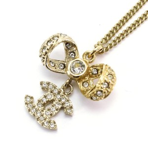 Chanel Gold Tone Rhinestone Ribbon Necklace