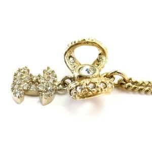 Chanel Gold Tone Rhinestone Ribbon Necklace