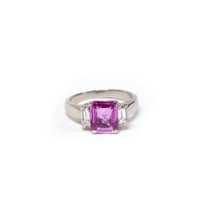 Platinum Ring With Pink Sapphire Center Stone And Baguette Shaped Diamonds