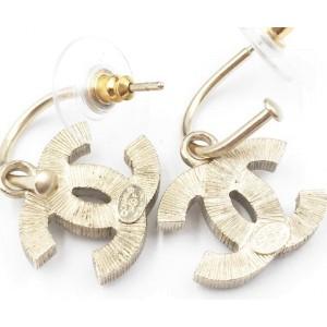 Chanel Gold Tone CC White Piercing Earrings