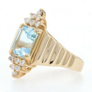 Yellow Gold Blue Topaz & Diamond Ring - 14k Emerald Cut 3.00ctw