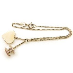 Vintage Chanel Coco Mark Gold Tone Hardware Heart Charm Bracelet