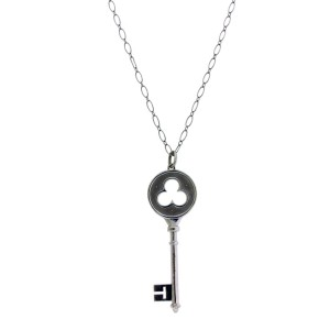 Tiffany & Co diamond key pendant necklace in 18k white gold 30 inches long