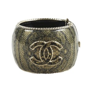 Chanel Gold Tone Metal and Resin Snakeskin Print Cuff Bracelet