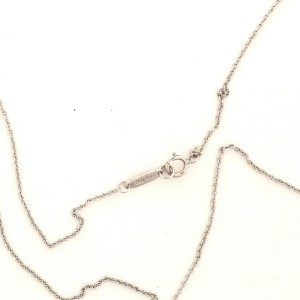 Tiffany & Co. Modern Open Round Key Pendant Necklace 18K White Gold with Diamonds