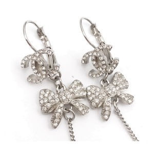 Chanel CC Silver Tone Crystal Bow Dangle Lever Back Piercing Earrings