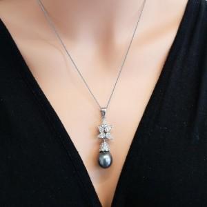 Black Tahitian Pearl and 1.71 Carat Total Pear Shaped Diamond Pendant
