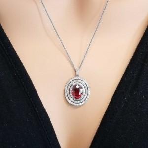 4.77 Carat Oval Spessarite Garnet and Diamond White Gold Pendant