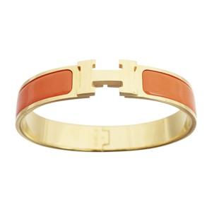 Hermes Gold Tone Metal And Enamel Click Clack Bangle Bracelet