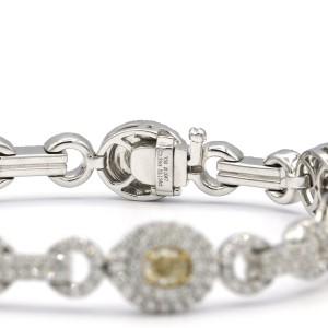 2.33 Carat Seven Oval Shaped Fancy Light Yellow Diamonds Bracelet 18 Karat Gold