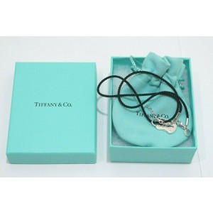 Tiffany & Co. Sterling Silver Lock Key Hole Pendant Silk cord Necklace