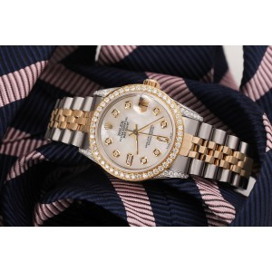 Difference for Women's Rolex 31mm Datejust Two Tone Diamond Bezel & Lugs White MOP Mother Of Pearl with 8 + 2 Accent   68273