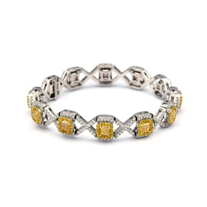 10.36 Carat 12 Radiant Fancy Yellow Diamonds In 18 Karat Yellow Gold Bracelet