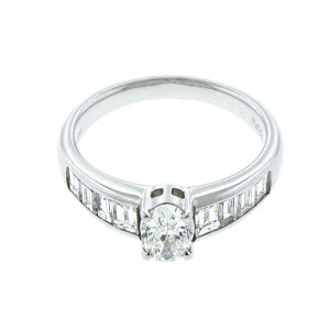 Platinum Oval and Emerald cut Diamond Ring