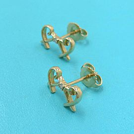 Tiffany & co. 18k Yellow gold Double Rubbing Heart Diamond Pierce