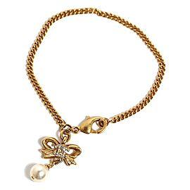 Chanel Gold Tone Metal Rhinestone and Glass Simulated Pearl Ribbon Charm Bracelet