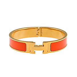 Hermes Gold Tone Orange Enamel Narrow Clic Clac Bracelet