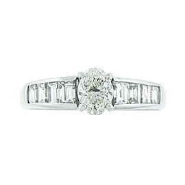 Platinum Oval and Emerald cut Diamond Ring