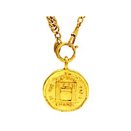 Chanel CC Logo Gold Tone Metal Rue Cambon Paris Medallion Necklace